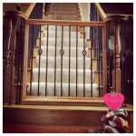 baby gate on large wooden staircases